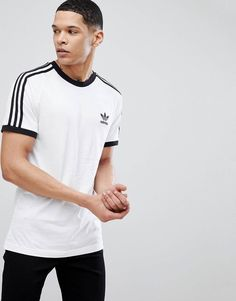 Order adidas Originals adicolor california t-shirt in white online today at ASOS for fast delivery, multiple payment options and hassle-free returns (Ts&Cs apply). Get the latest trends with ASOS. Looks Adidas, Adidas Retro, Evolution Of Fashion, Summer Outfits Men, Sport Wear, Mens Clothing Styles, Nike, Asos, T Shirt