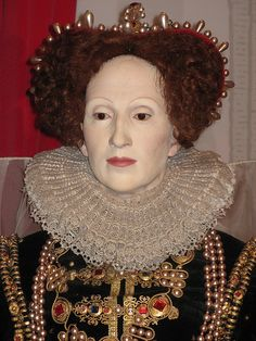 Queen Elizabeth I: eyebrows severely plucked, hairline plucked, possibly powdered face.