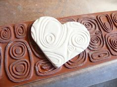 """Polymer Clay Heart with texture.  I cannot wait to try """"rubber stamping"""" on polymer clay.  These might make easy ornaments, once I knead the clay that is."""