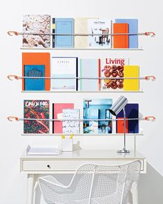 Don't hide pretty notebooks and reading materials inside your desk -- organize them on ledges and secure them with adjustable bungee cord. To make this DIY shelf, get the corner molding and hooked cords at your local hardware store. Paint as desired, then attach them to the wall, and you've got a gallery you can switch up as often as you like.