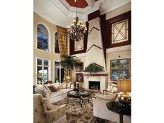 775 Galleon Drive, Naples, FL 34102 | Traditional living room - fireplace, chandelier, amazing trim work | Port Royal in Naples, Florida