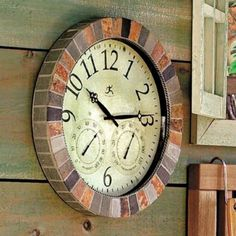Slate Indoor/Outdoor Clock.  I love that this clock measures the temps and humidity also.  From Ballard Designs.