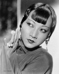 <p>Arched wasn't the only desirable shape in the '30s, though. Here, silent-film actress Anna May Wong shows off an ultraskinny, straight brow that goes well with her equally delicate, Cupid's bow lips.<i>(Photo: Getty Images)</i></p>