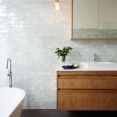 """44 Likes, 4 Comments - Bailey Walton (@bailey.walton.design) on Instagram: """"Textured mint subway tile and a floating oak vanity brings warmth to this modern bathroom, while…"""""""