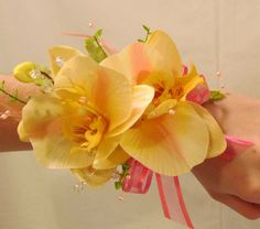 yellow orchid wrist corsage= what I am doing for prom except with blue and better done