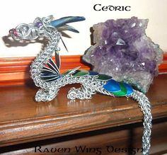 Cedric   by Raven Wing Design  This dragon sculpture was made with a variety of weaves - captive inverted round, half Persian 3-1, box chain and Byzantine. Made using bright aluminium, id 4mm, 1.29mm; id 5mm, 1.29mm; and id 10.3mm, 1.63mm and blue and green anodised aluminium scales, via beadsisters.co.uk