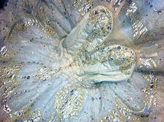 gold embellished classical ballet tutu on white ground