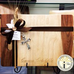 Custom engraved Verdici Acacia wood cutting board. At Importer's Gifts we will engrave these based on the last name of your recipients/party guests so that each guest will receive their own board with their last name or monogram engraved right into the wood ! Great for first holy communion, baptism, and confirmation favors/Bomboniere .