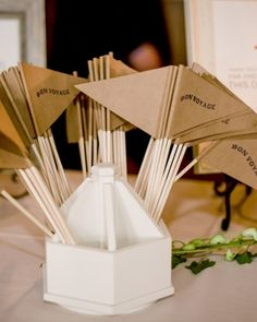 """Guests waved """"Bon Voyage"""" flags to wish farewell to the bride and groom in this travel-inspired DIY wedding in Milwaukee."""