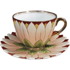 This old porcelain cup and saucer set is beautifully decorated as a petaled flower. Both pieces are embossed with the petal design and hand painted with a lovely combination of colors. The petals are