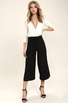 Show 'em you're a strong, stylish woman when you walk by in the Walk On Black Culottes! A tying waist (with elastic) tops these chic culottes composed of sleek woven poly. Front diagonal pockets.