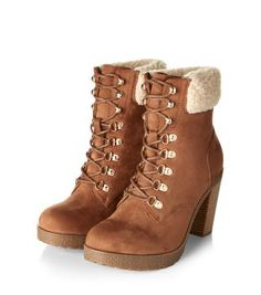 - Faux shearling cuff- Lace up fastening- Block heel