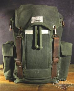 This is a really big hand waxed canvas and leather backpack and is perfect for your hiking, camping or travel bag. Olive green, brown genuine