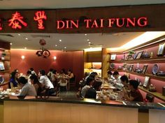 Din Tai Fung, Wisma Atria, Orchard Road, Singapore.  Considered as one of the best restaurants in the world.  They have the most AMAZING Xiao Long Bao, an especially difficult to make dumpling with soup in it.  Take a bite and a sip and let the warm broth wash over your tongue as you slip the velvety soft dumpling into your mouth.  Anyone who goes to Singapore needs to eat here at least once.  I still miss it.