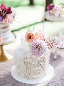 Ruffle wedding cake with silver tier and pastel flowers