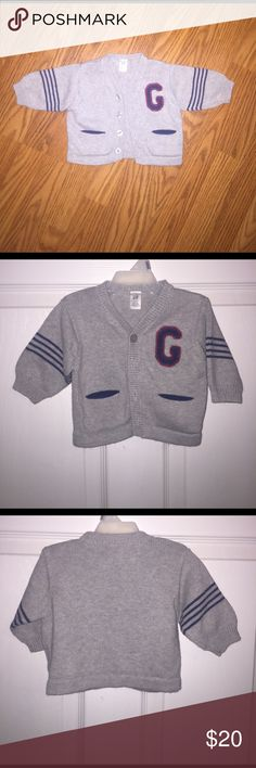 "Baby Gap Varsity Sweater How precious is this sweater?!? It would be such a great addition to your little mans wardrobe! Baby Gap size 3-6 Months. Grey body with blue accent pockets. Four blue strips around sleeves. Blue ""G"" over red background. In great condition! No tears or holes! Baby Gap Shirts & Tops Sweaters"