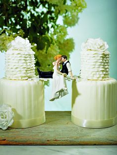 wedding cake topper - if we do multiple cakes over the moss bedding this or the book between cakes would be adorable