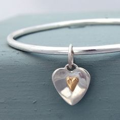 Flutter handmade silver bangle with 9ct gold heart charm
