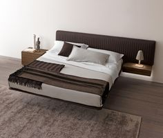 Wing system_up bed with headboard upholstered with stretch Nappa tecnopelle. Slatted base with frame upholstered with Nappa Tecnopelle supported by a..