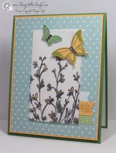 flower stems on vellum on white, topped ewith butterflies. like the three little banners on the side