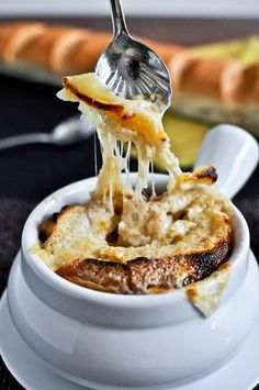 Crockpot French Onion Soup [adapted from Tyler Florence] makes a giant pot, about 8-10 servings 4 medium sweet onions, thinly sliced 3 garlic cloves, minced 4 tablespoons of butter 2 tablespoons balsamic vinegar 2 tablespoons brown sugar 3 tablespoons flour 8 ounces of beer 64 ounces of low-sodium beef stock 2 tablespoons fresh thyme 1/2 teaspoon black pepper 1/2 teaspoon salt french bread gruyere cheese, sliced Set your crock pot on high, then add onions, garlic, brown sugar,...