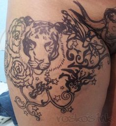 Tiger on leg tattoo
