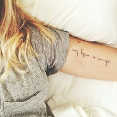 minimalist font. up the ankle, under arm.