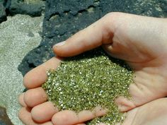Handful of green sand from Green Sand Beach at the southern tip of the island of Hawaii (Kona).