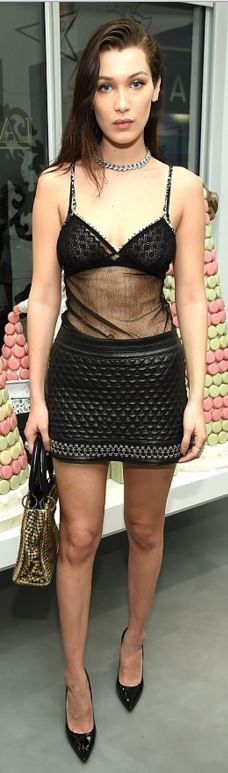 Bella Hadid: Shirt – Chanel  Skirt – Balmain