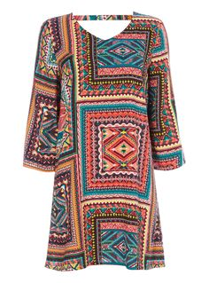 Brighten your holiday wear with this vibrant patterned dress, designed with a plunging back supported by a stylish neck strap. Wear with colourful sandals to complete the look. Multicoloured voodoo patchwork dress Three quarter sleeves Pattern design V-neckline Plunge back with strap Model's height is 5'11 Holiday Wear, Patterned Dress, Patchwork Dress, Voodoo, Dress Patterns, Pattern Design, Baby Kids, Vibrant, Neckline