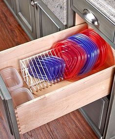 "Bring order to your kitchen with a Space-Saving Storage Organizer. The Lid Organizer (14-1/4""W x 5-3/8""D x 5-1/8""H) is designed to hold up to 20 of your plastic"