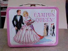 I had this lunch box. It had a game on the back with magnetic pieces.