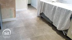 A mixture of warm beige and mid-grey tones in this limestone inspired design takes the floor in this kitchen. It's hard to not agree that Corey has completed yet another pristine installation of Karndean Portland Stone LVT. Kardean Flooring, Karndean Design Flooring, Kitchen Flooring, Portland Stone, Kestrel, Luxury Vinyl Tile, Green Kitchen, Fern, Tile Floor