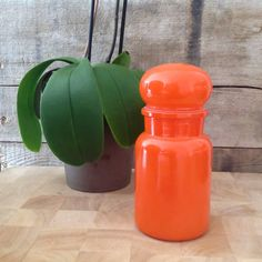 Beautiful rare orange glass apothecary/ pharmacy jar with bubble stopper made in Belgium.  The container is marked on the bottom CONTAINER MADE IN