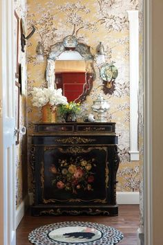 Such pretty wallpaper and painted chest..I could see this in a powder room.