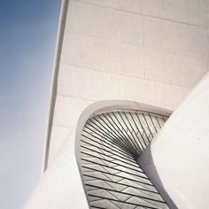 Tenerife\'s Auditorium: Project: Auditorio de Tenerife Architect: Santiago Calatrava Project Location: Santa Cruz de Tenerife, Spain Project Date: 2003Situated on the Canary Island, this concert hall also stands as a landmark. In white concrete, Calatrava exaggerated a wave form to make it feel as if it is going to dive into the ocean, creating an implied relationship between nature and architecture.