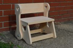 Ships fully assembled!!! Step Stool Bench folds down for use as a step stool, or lift the front up to the stop in the back for a seat for your tired or bored little ones!!!  This is the cutest item for your young one that wants to help you out in the kitchen, reach the sink in the bathroom, or just raise themselves up to see what is going on! This Step Stool Bench is easy on the eyes with a sleek design including intricate scroll work with the hearts, but there is more than meets the eye…