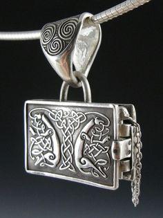 http://www.etsy.com/listing/63300930/book-of-kells-locket-guardian-hounds