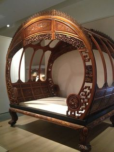 19th century carved Chinese bed. Some Hobbit would be right at home in this. Bonus: You could fit it through the door in one piece.