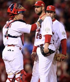 Yadier Molina thanks Chris Carpenter for his work before he is releived from the game in the seventh inning during Game 7 of the World Series between the Texas Rangers and St. Louis Cardinals at Busch Stadium on Friday October 28, 2011 in St. Louis.