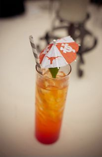 Fun drinks served with UT umbrellas! Photography by Stacy Cross #UT #wedding #drink