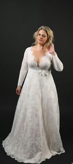 Plus size lace deep v-neck, long sleeves a-line wedding gown. Sophia. Studio Levana