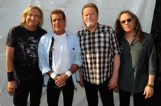 """In 1972 the Eagles began recording their self-titled debut album, which featured the band's first hit """"Take it Easy."""" Who re-recorded the song for the 1993 Eagles tribute album """"Common Thread: The Songs of the Eagles""""? Eagles Music, Eagles Lyrics, Eagles Band, Pop Rock, Rock N Roll, Eagles Tickets, Eagles Take It Easy, Rock Bands, Entertainment"""
