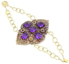 """Nola Singer """"Priscilla"""" Filigree Vertical Purple Stone Brooch Chain Cuff Bracelet Nola Singer. $400.00. 14k gold fill cuff is 7 inches in length, vintage filigree brooch is 3 inches in height by 2 inches in width. Unique, feminine, vintage, timeless, and chic. Handmade in Los Angeles CA, intricate filigree design, one of a kind. Sterling silver ring, with vintage 1920's baby blue and dark blue rectangle rhinestone earring as a ring. Made in United States"""