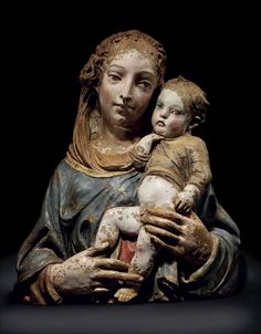 A PARCEL-GILT POLYCHROME TERRACOTTA AJOUREE RELIEF OF THE VIRGIN AND CHILD -  FLORENTINE, CIRCA 1420