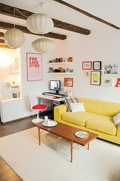 yellow couch, beams on the ceiling, pops of color.