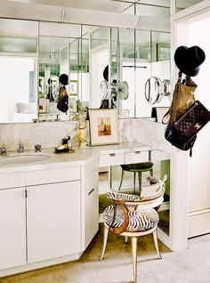 Mirrored wall in bathroom with vanity