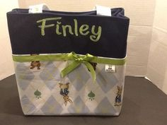 Personalized diaper bag with lots of pockets made with Peter Rabbit fabric by MandaPandaBagsandMor on Etsy