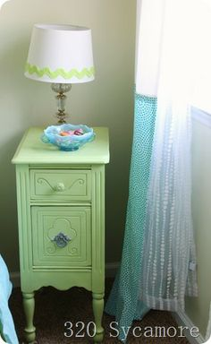 little green night stand with beadboard wallpaper