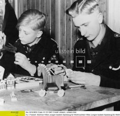 Boys in the Hitler Youth make toys for Christmas